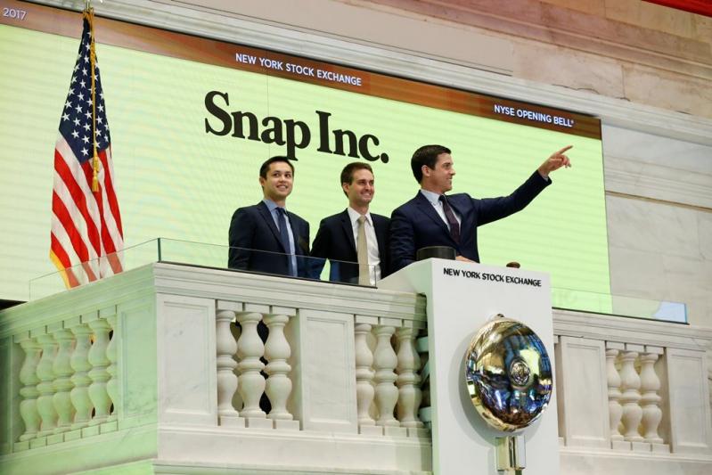 Los co-fundadores de Snapchat en la bolsa de Nueva York.