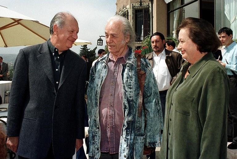 Una postal que data del 2001, junto al entonces presidente Ricardo Lagos y su esposa, Luisa Durán