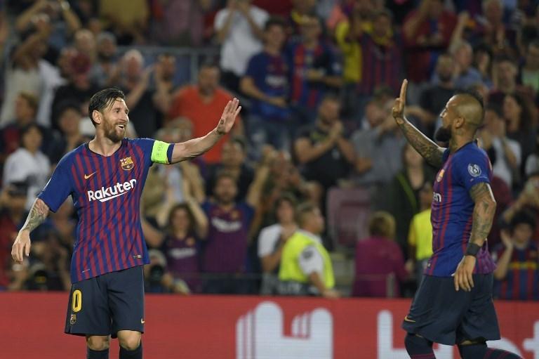 Lionel Messi y Arturo Vidal