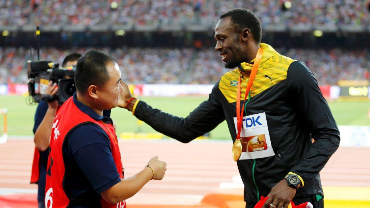 Usain Bolt se reencuentra con camarógrafo que lo atropelló