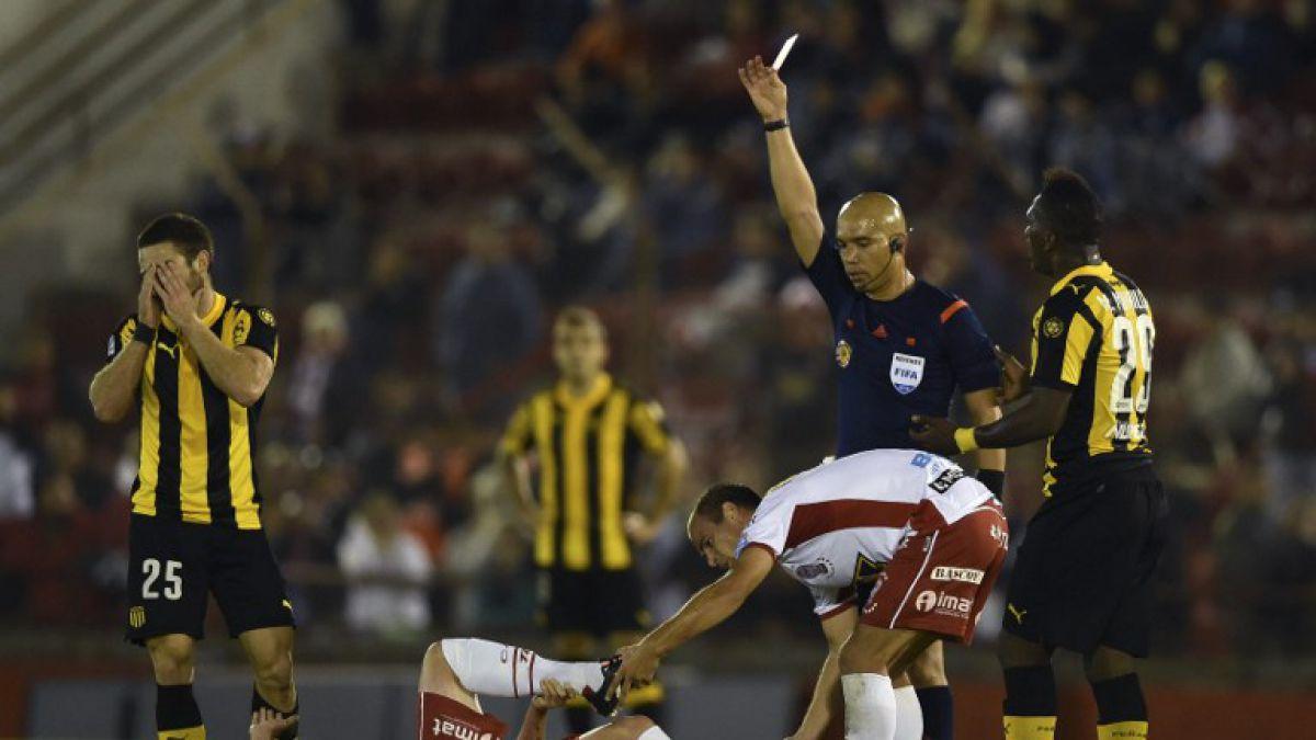 Peñarol dijo adiós de la Copa Libertadores tras empatar con polémica ante Huracán