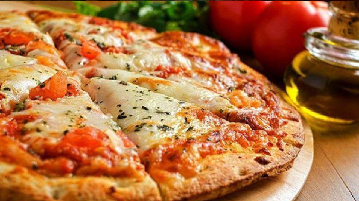 C mo la pizza hawaiana se convirti en la m s for Mundo pizza la algaba