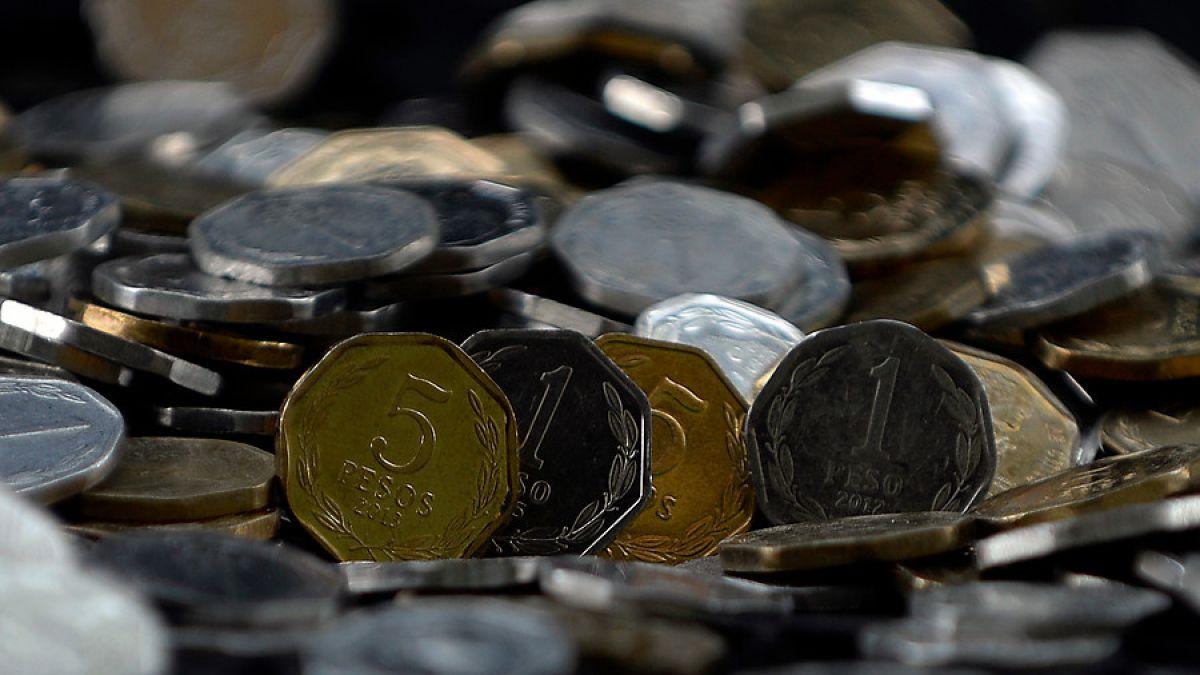 Termina en Chile circulación de monedas de uno y cinco pesos