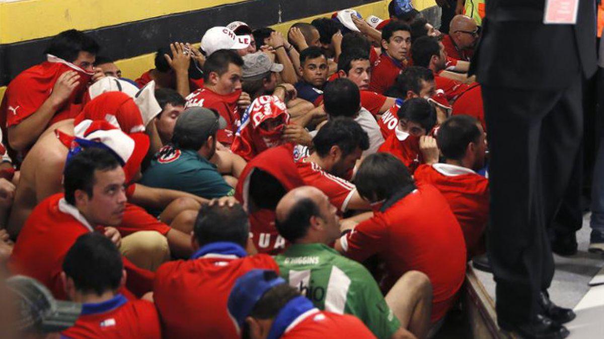 ANFP impedirá ingreso a estadios chilenos a hinchas que causaron desórdenes en Brasil