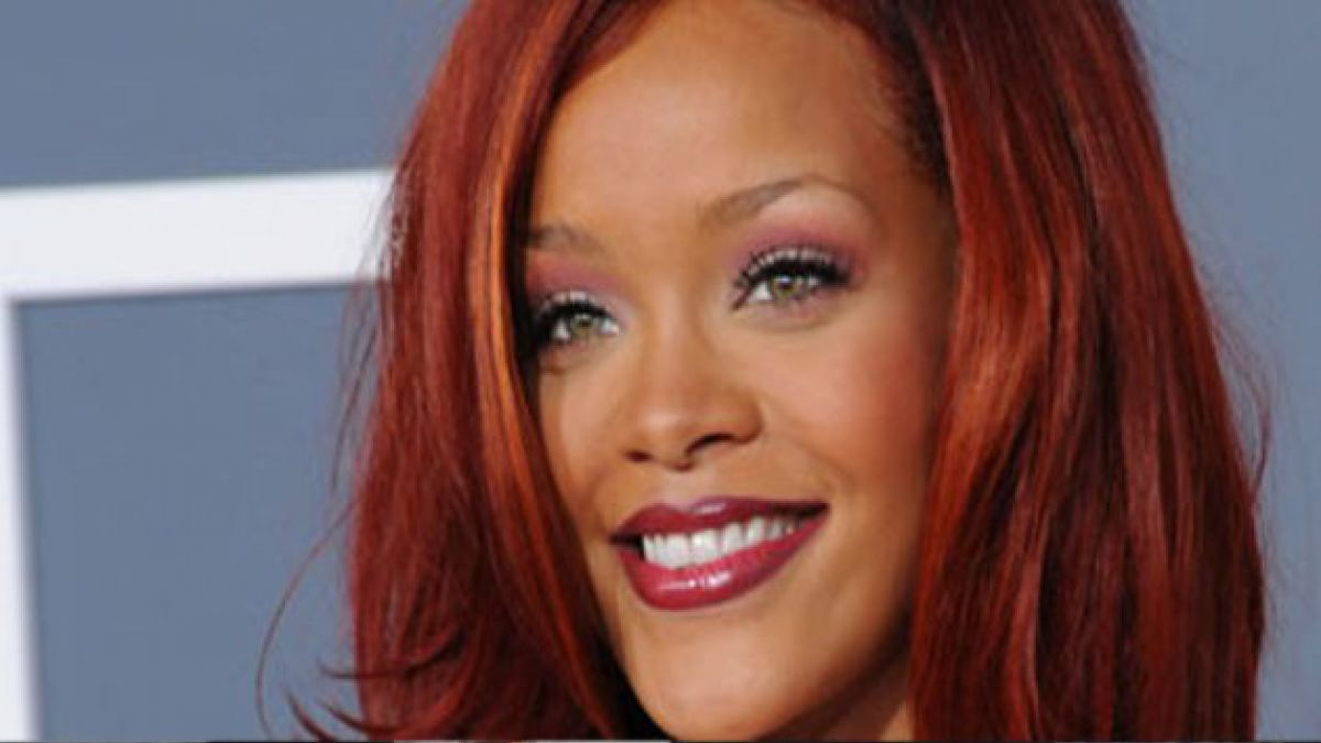 Rihanna invita a Ashton Kutcher a Londres