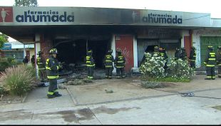 [T13 AM] Incendio en farmacia de La Florida tras posible alunizaje