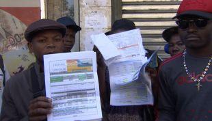 [VIDEO] Haitianos reclaman por dinero gastado en viajes afectados por LAW