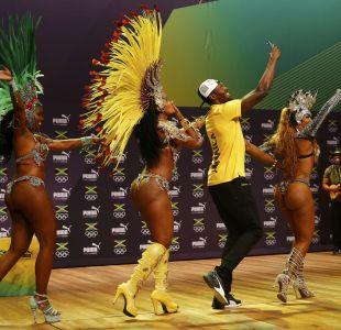[FOTOS] Así fue la performance de Usain Bolt junto a bailarinas brasileñas