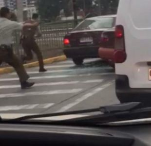 [VIDEO] Carabinero usó arma de servicio en la calle para repeler asalto en Peñalolén