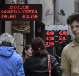 Tensa expectativa en mercados por caída del peso argentino