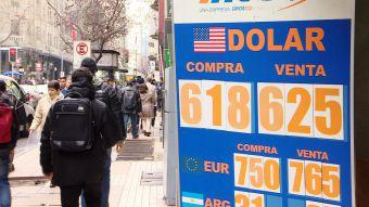 T13 baja del dolar